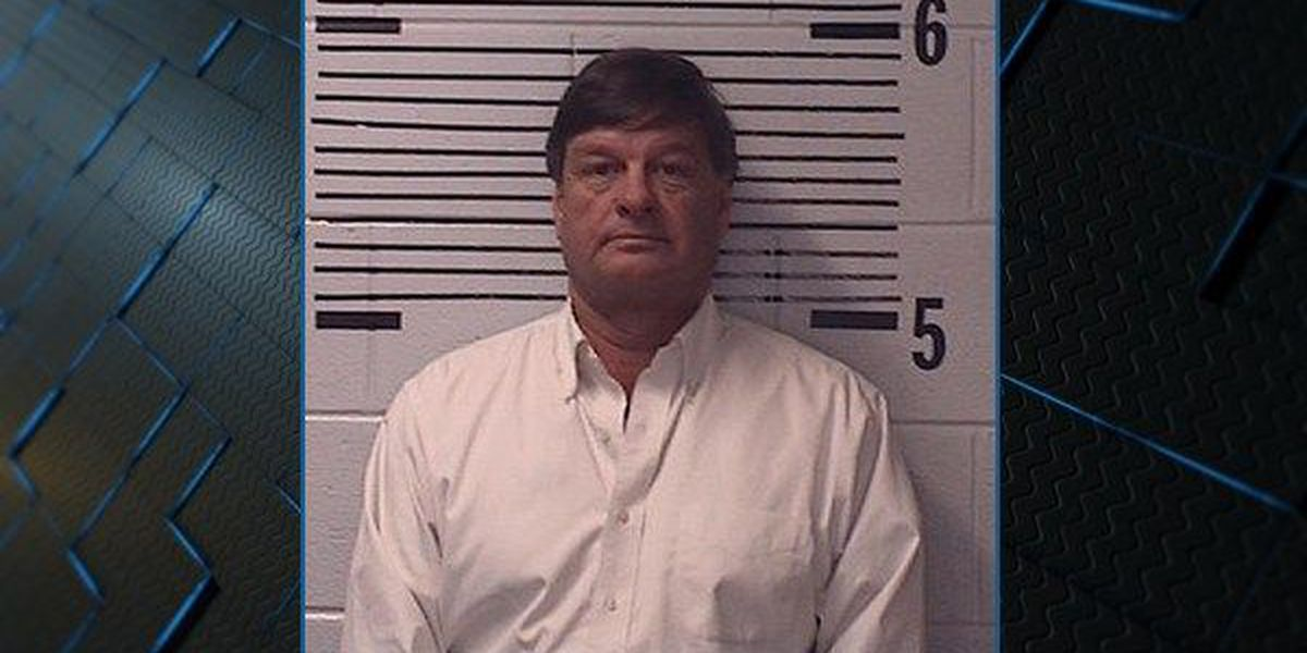 Elmore County commissioner charged with using his office for personal gain