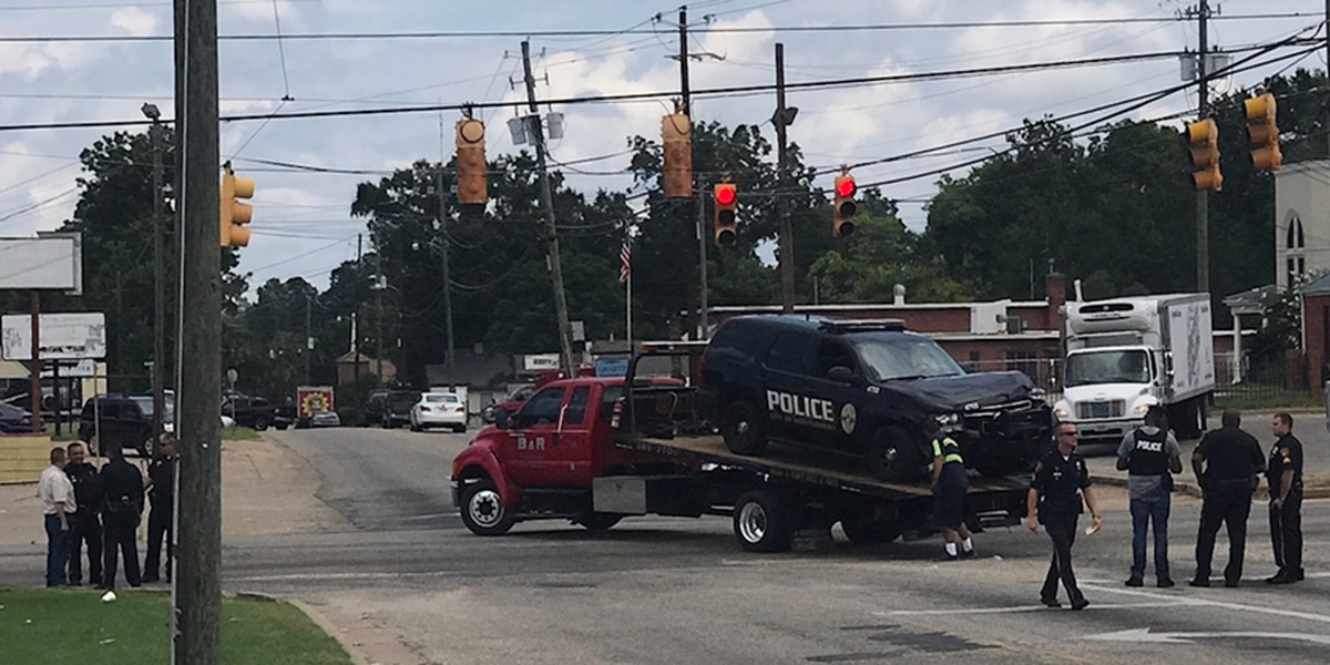 Montgomery police officer, passenger car involved in wreck