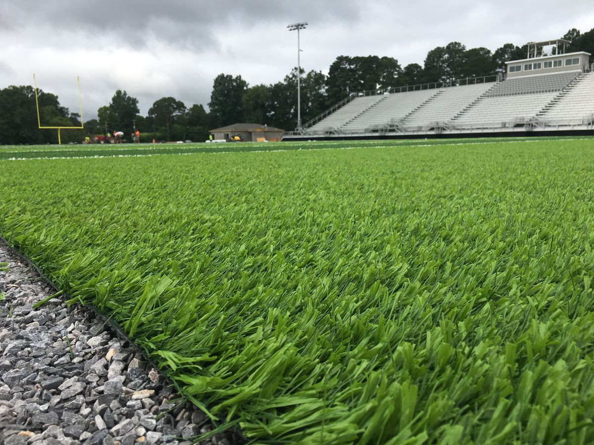Workers lay turf at new Wetumpka stadium