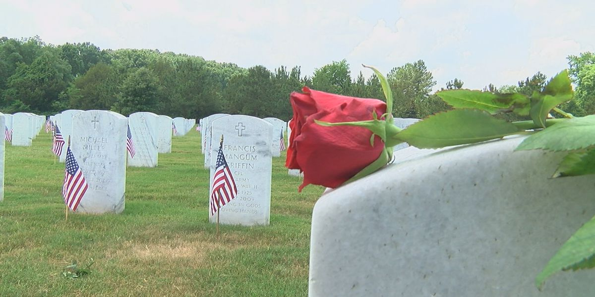 Veterans, volunteers place thousands of roses on graves at Alabama National Cemetery