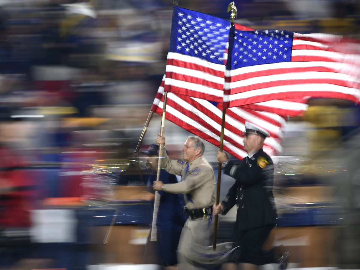 Rams honor firefighters, police for recent heroic actions