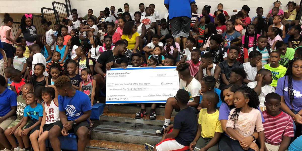 Shaun Dion Hamilton donates check to Boys & Girls Club