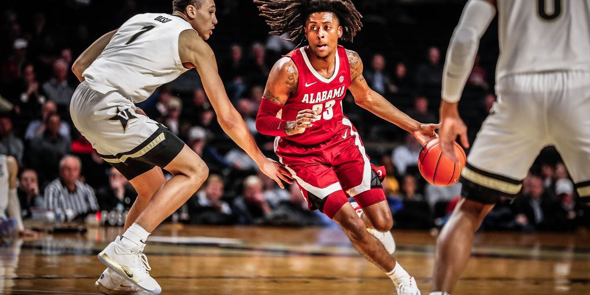 Petty surpasses 1K career points in Tide win