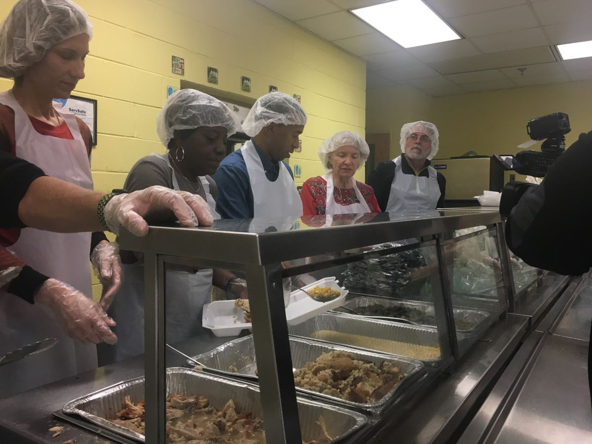 Volunteers give out hundreds of free meals across River Region
