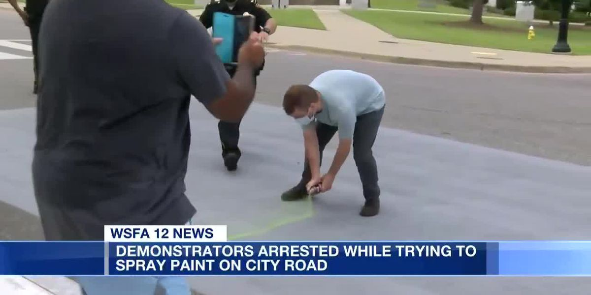 Demonstrators arrested while trying to spray paint on city road