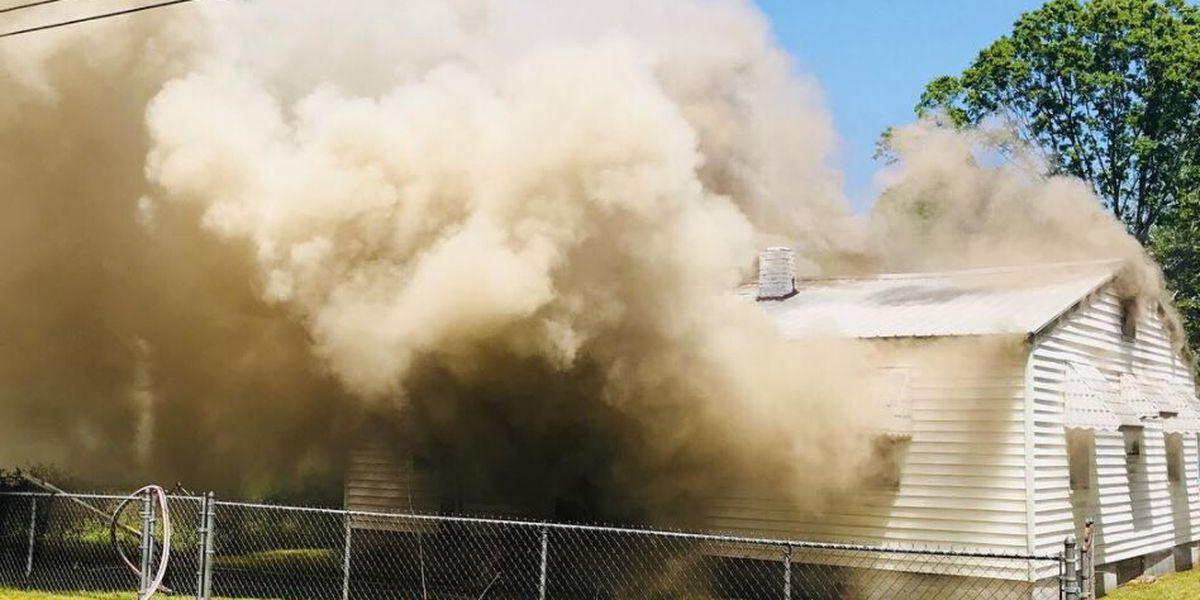 MFR investigating fire that left civilian, firefighter injured