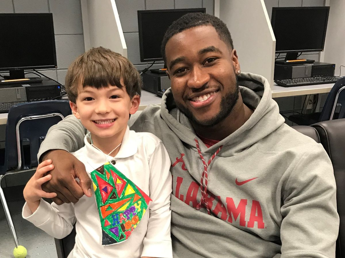Former Carver standout, current NFL player Shaun Dion Hamilton visits old elementary school