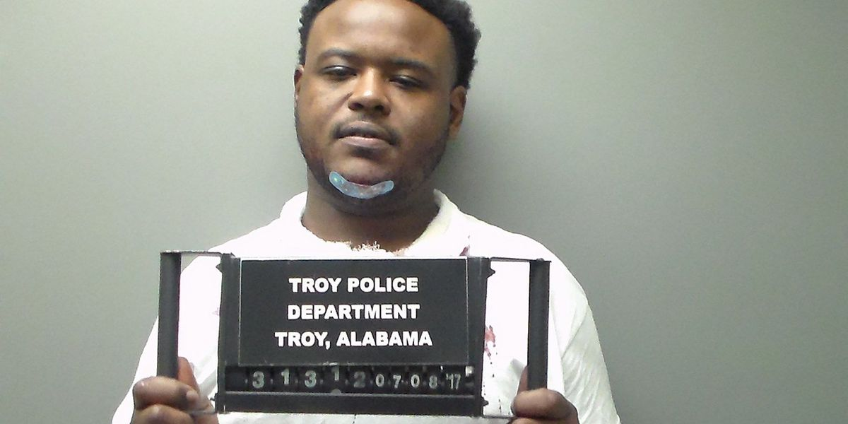 Police: Troy officer caught in car door as suspect tries to flee