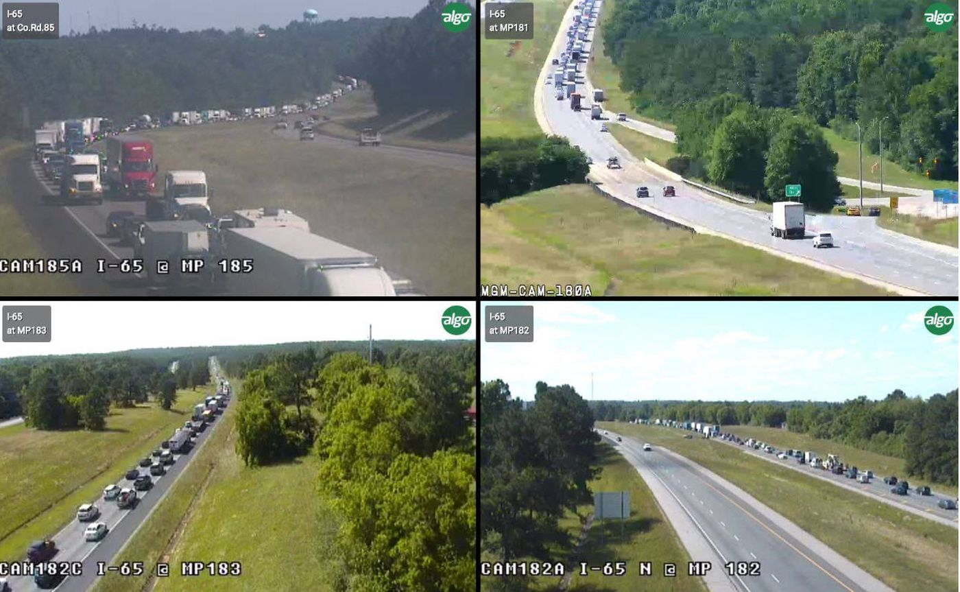 Four photos from the Alabama Department of Transportation's traffic camera system showed delays on I-65 in northern Autauga County due to a fatal crash.
