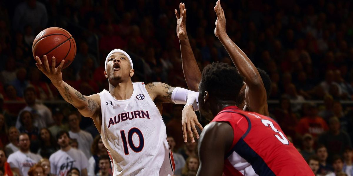 Auburn downs Ole Miss to extend home streak
