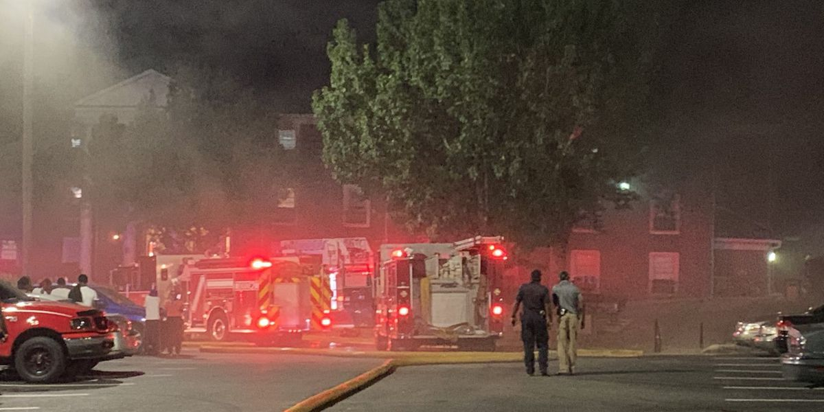 A student jumps from his dorm room during a fire at Miles College