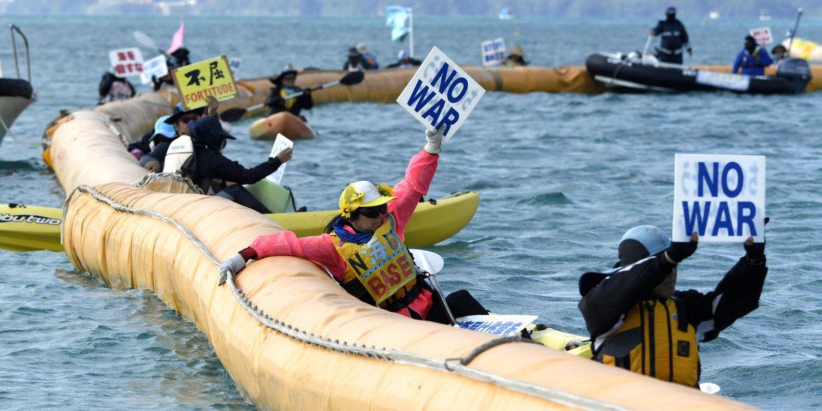 Japan begins reclamation at disputed US base despite protest