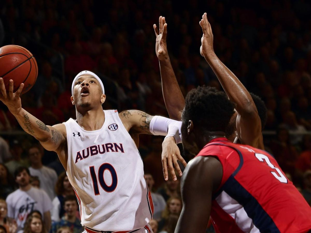 Auburn downs Ole Miss to extend home streak