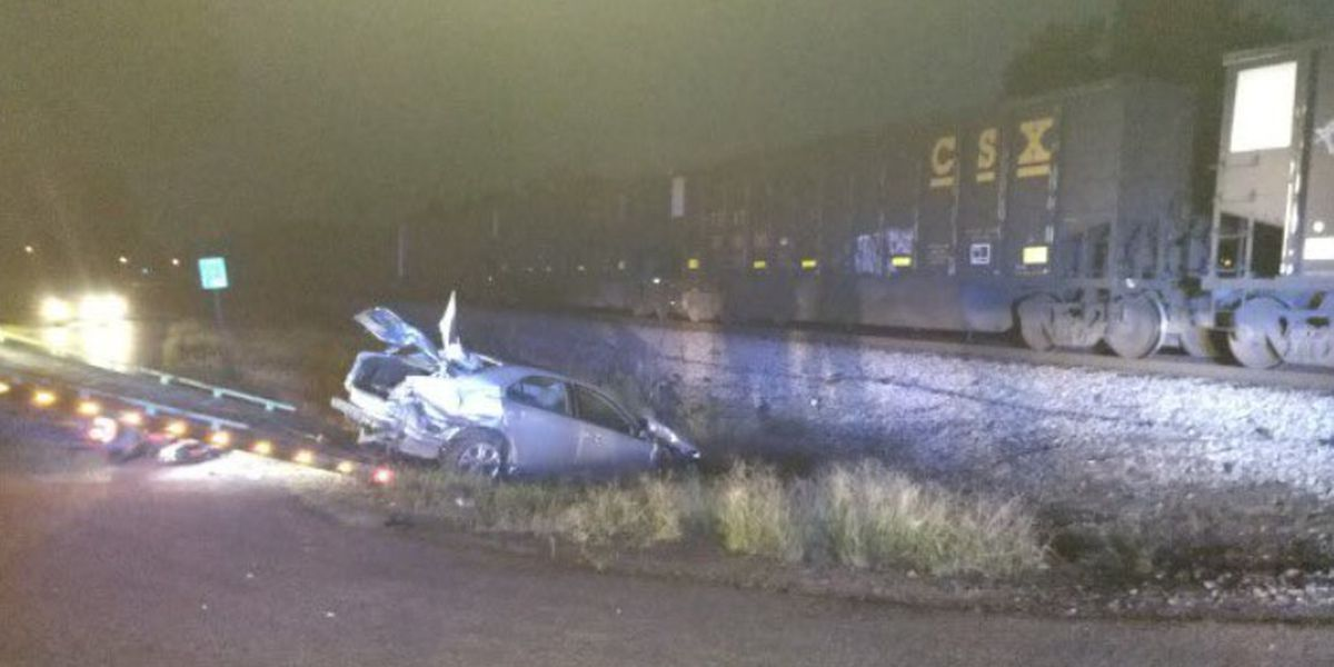 Driver remains in hospital after collision with train