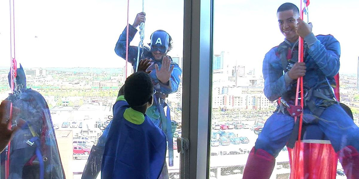 Superheroes surprise kids at Children's Hosptial