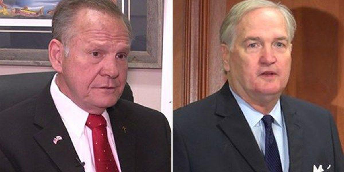 Moore, Strange trade accusations over debate
