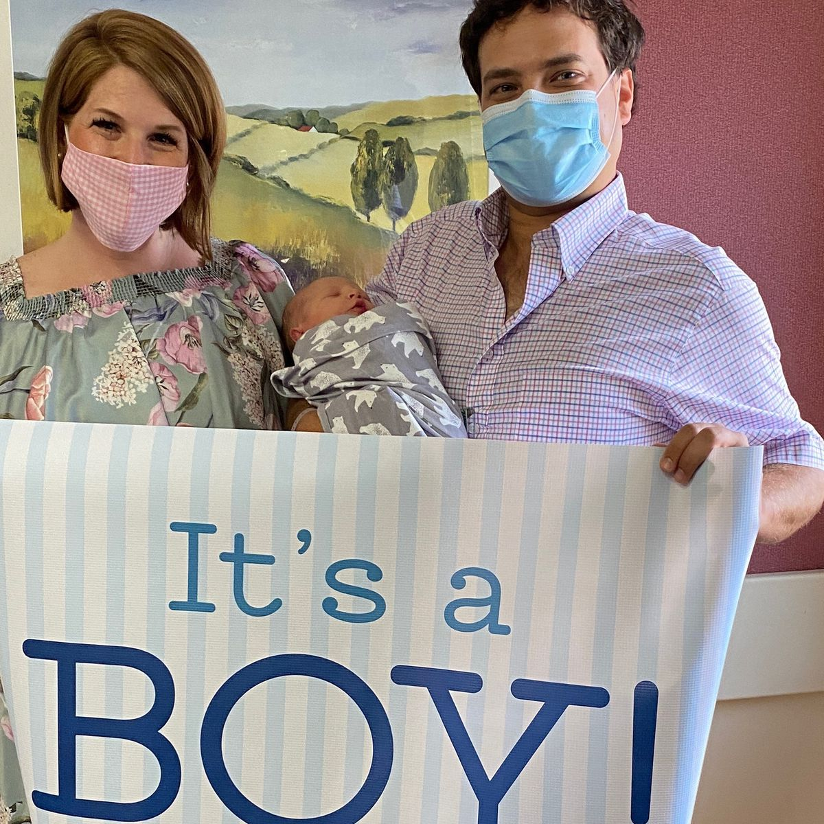 Newborn baby meets family through hospital window