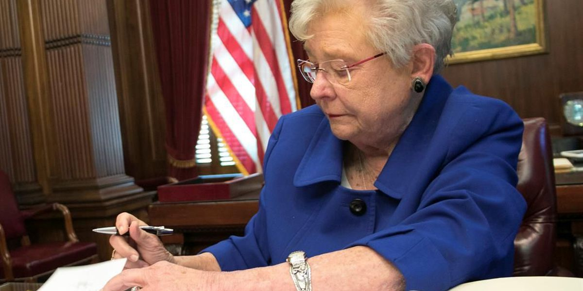 Ivey signs executive order on administration pay