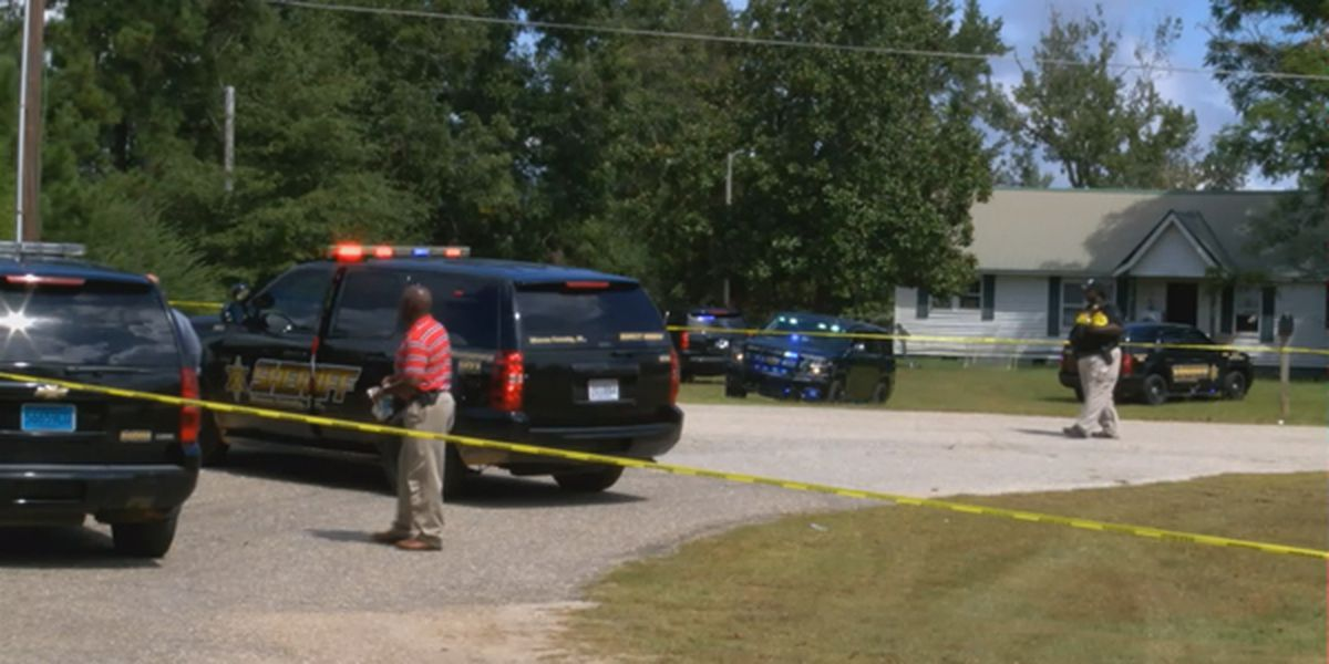 Carjacking, manhunt ends with suspect shot in Macon County