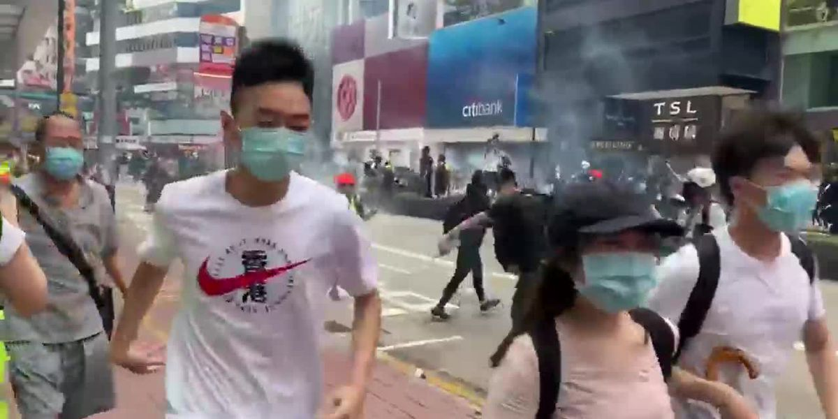 RAW: Hong Kong protesters hit with tear gas