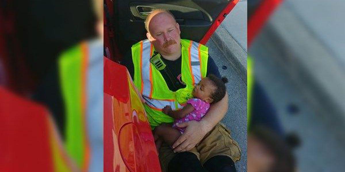 Photo shows TN fireman comforting baby girl after crash