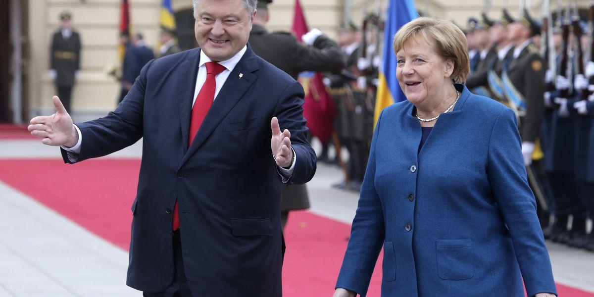 Merkel visits Ukraine, says anti-Russian sanctions will stay