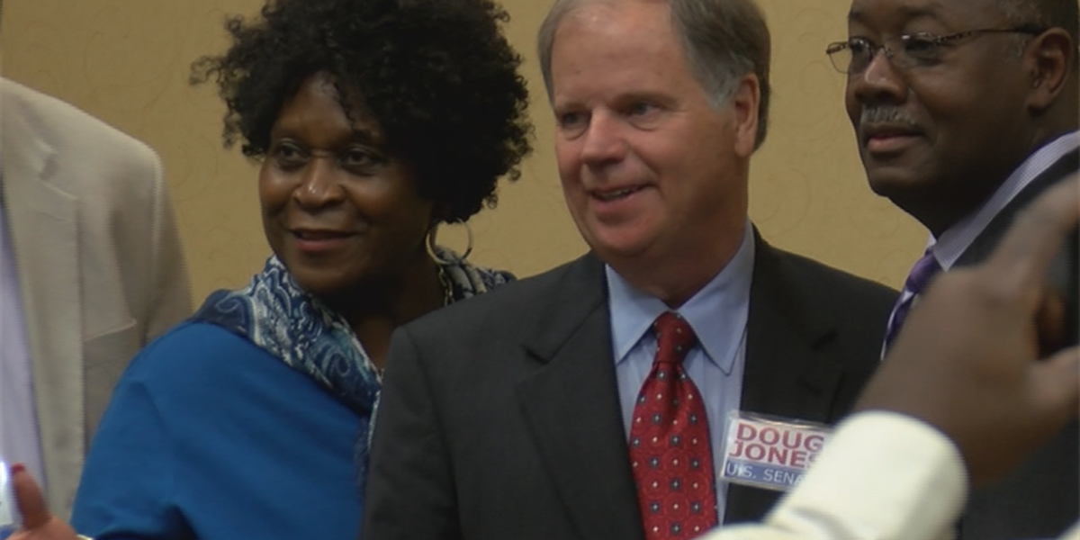 Doug Jones rallies support while promoting differences from Moore
