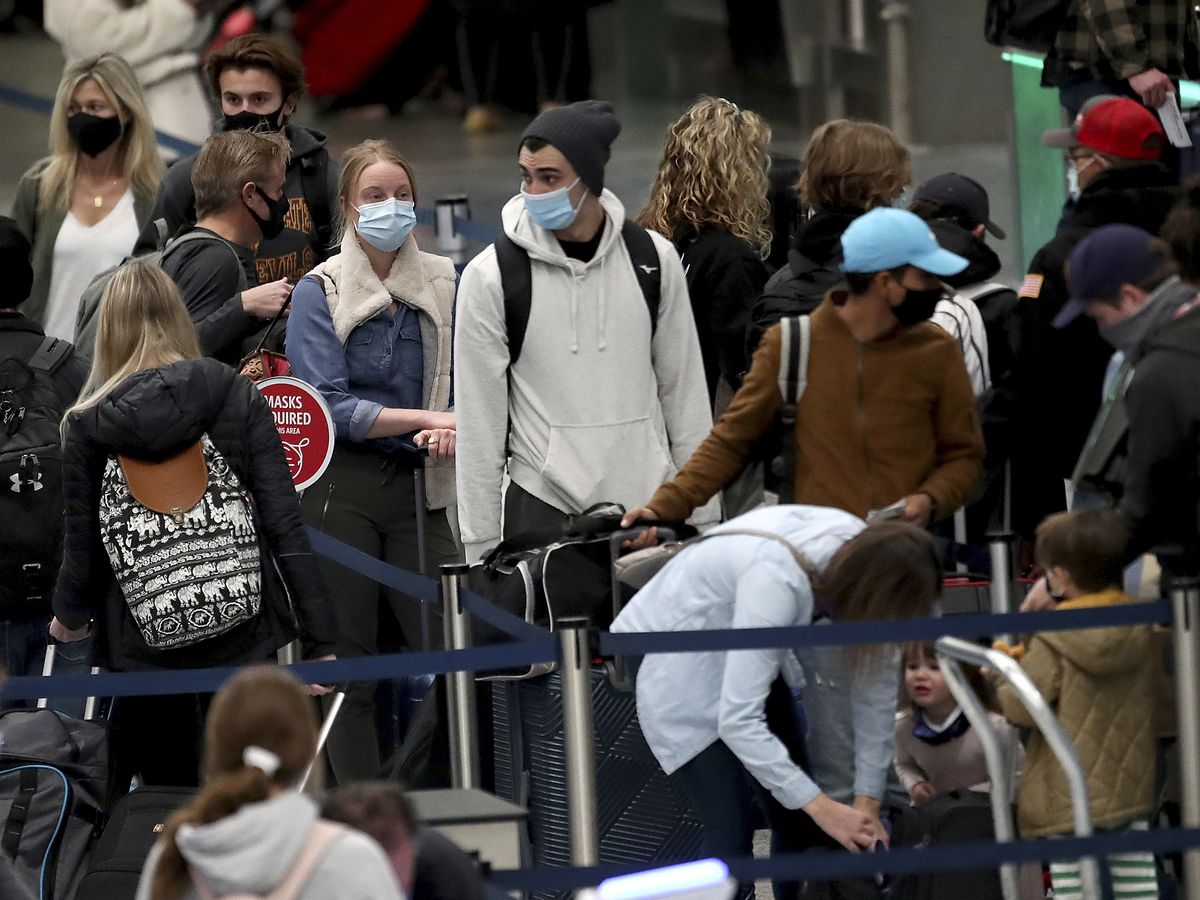 Thanksgiving travelers try to reach destinations, miss virus