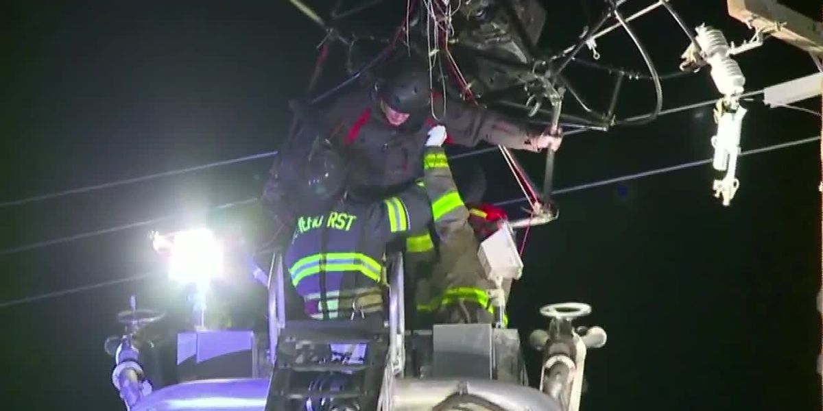 Crews rescue paraglider trapped in power lines