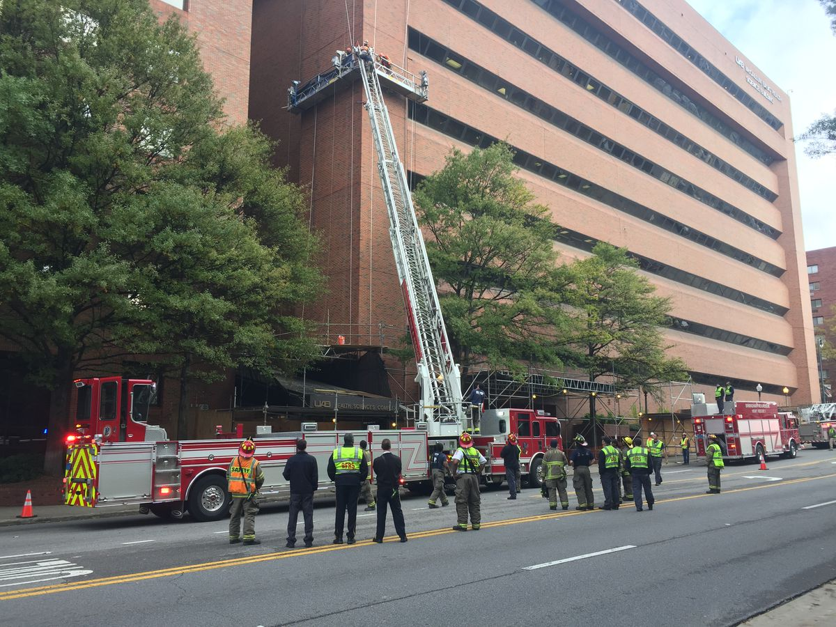 Firefighters working to rescue workers stuck on UAB high rise