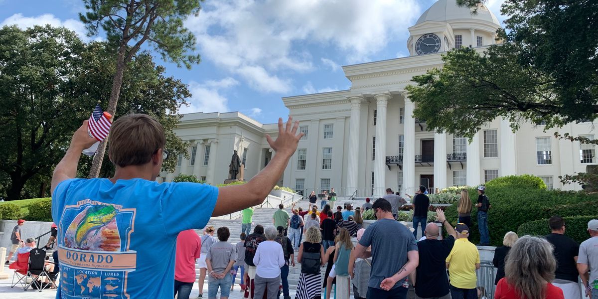 Protest against church closures held outside Alabama Capitol