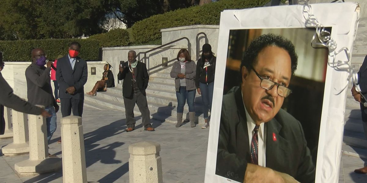 Mourners march in honor of former state Rep. Alvin Holmes