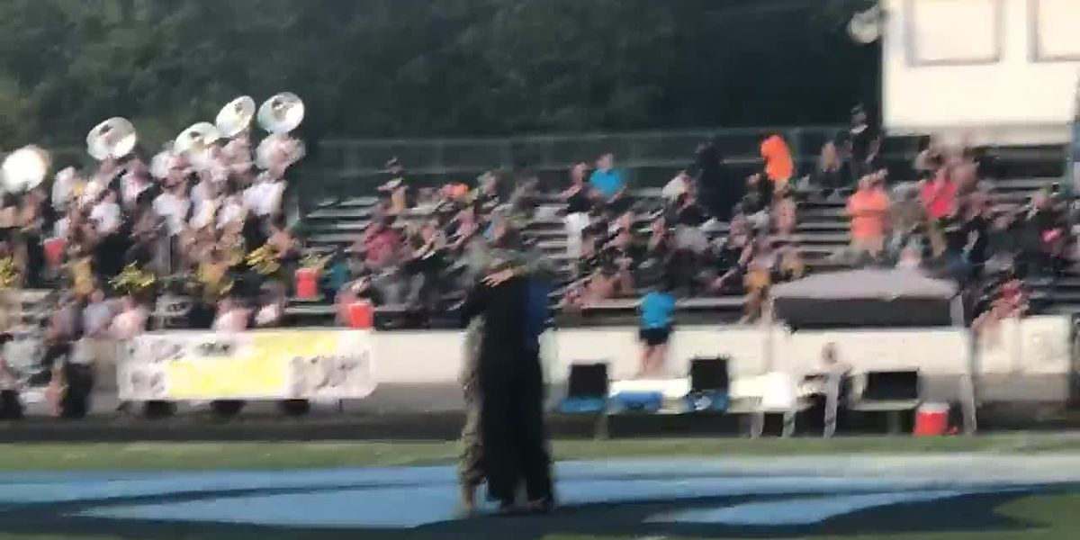 Soldier surprises sister at football game