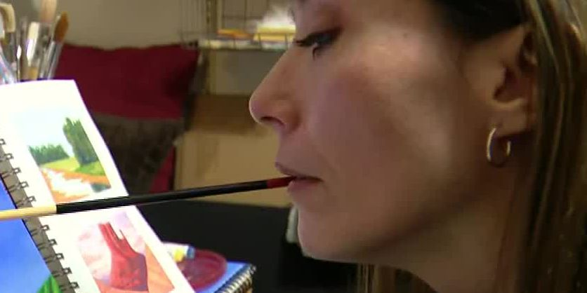 Artist doesn't let paralysis stop her from creating. She paints with her mouth.
