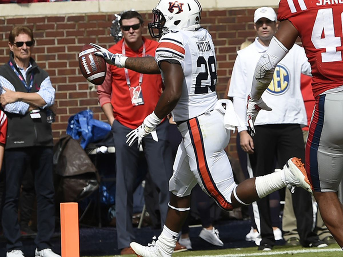 Auburn runs over Ole Miss 31-16