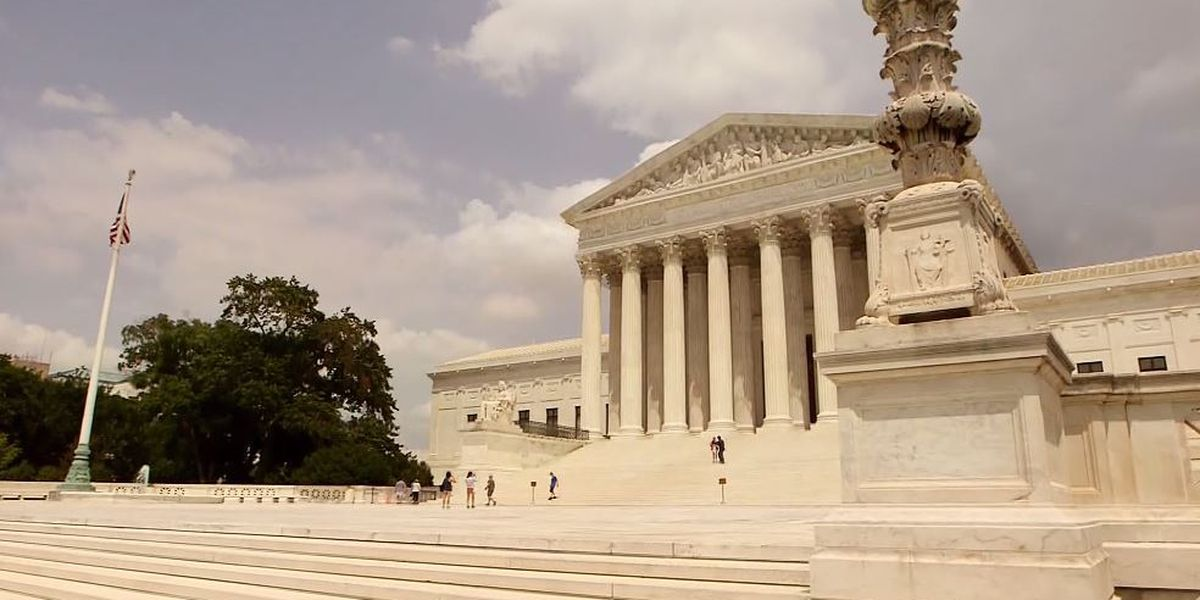 Divided Supreme Court weighs LGBT people's rights